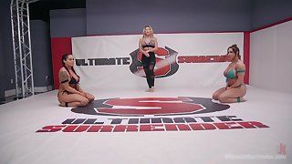 Muscled Brandi Mae and Jasmeen Lefleur take turns with a strap on