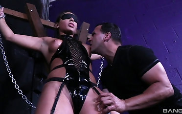 BDSM action with submissive Abella Dare whose tits get sucked