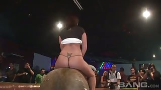 Horny bimbos riding the mechanical bull while being half naked