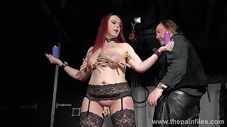 Bootylicious redhead in black stockings Kitty is skinned for some bondage